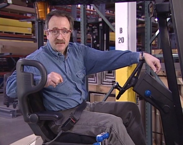 A safety trainer discussing forklift operator safety and avoiding injury while operating a forklift