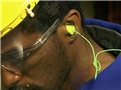 A worker using proper hearing protection and following his facility's hearing conservation program