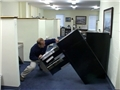 An office worker injured by a filing cabinet tipping over because safe work practices were ignored