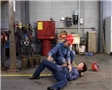 A re-enactment of a workplace accident resulting in a worker being injured from a slip, trip or fall