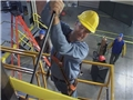 Maintenance workers using safe work procedures to reduce the chance of getting injured while at work