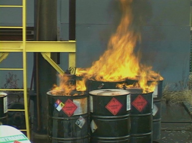 An example of a dangerous workplace fire that was preventable involving some chemical barrels