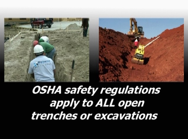 Workers in an open trench and a machine on an excavation site where OSHA safety regulations apply