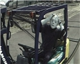 A dummy driving a forklift in an unsafe manner and causing a forklift accident