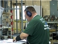 A worker wearing the proper hearing protection specified in the hearing loss prevention program