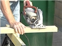 A worker using a power tool and following safe work practices to avoid serious injury while at work
