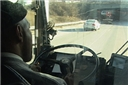 A bus operator driving safely and avoiding distractions to keep his attention on driving