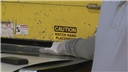A worker failing to use proper machine guarding or safety device is injured by a machine at work