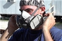 An industrial worker following the OSHA Respiratory Protection Standard and safety training