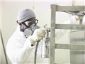 A worker wearing the proper respiratory protection to avoid potential workplace hazards and injury
