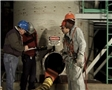 A safety manager training workers on confined space safety to avoid injury from workplace hazards